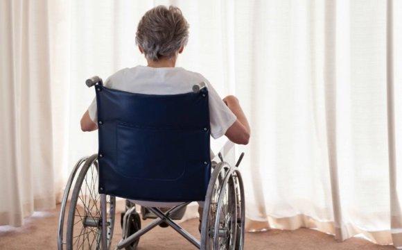 Пациент с БП на инвалидном кресле