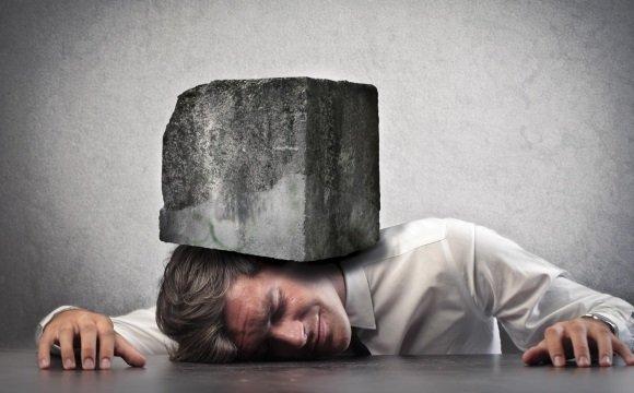 Чувство тяжести в голове
